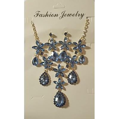 Набор серьги гвоздики и колье в металле под золото с голубыми кристаллами